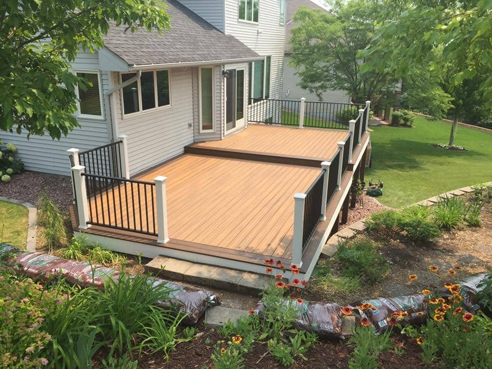 wooden deck with black fence